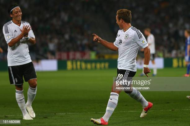 Mario Goetze of Germany celebrates scoring the first team goal with his team mate Mesut Oezil during the FIFA 2014 World Cup Qualifier group C match...