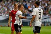 Mario Goetze of Germany celebrates the first goal with Jonas Hector of Germany during the International Friendly match between Germany and Hungary at...