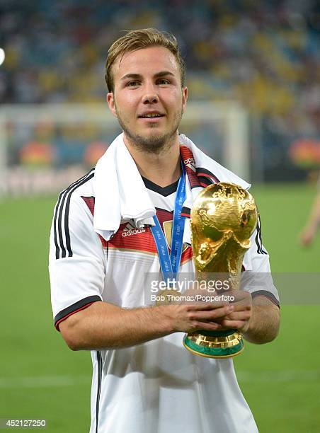 Mario Goetze of Germany celebrates with the trophy after the 2014 FIFA World Cup Brazil Final match between Germany and Argentina at the Maracana on...