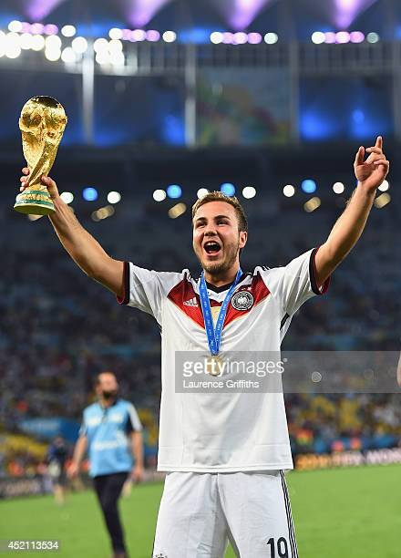 Mario Goetze of Germany celebrates with the World Cup trophy after defeating Argentina 10 in extra time during the 2014 FIFA World Cup Brazil Final...