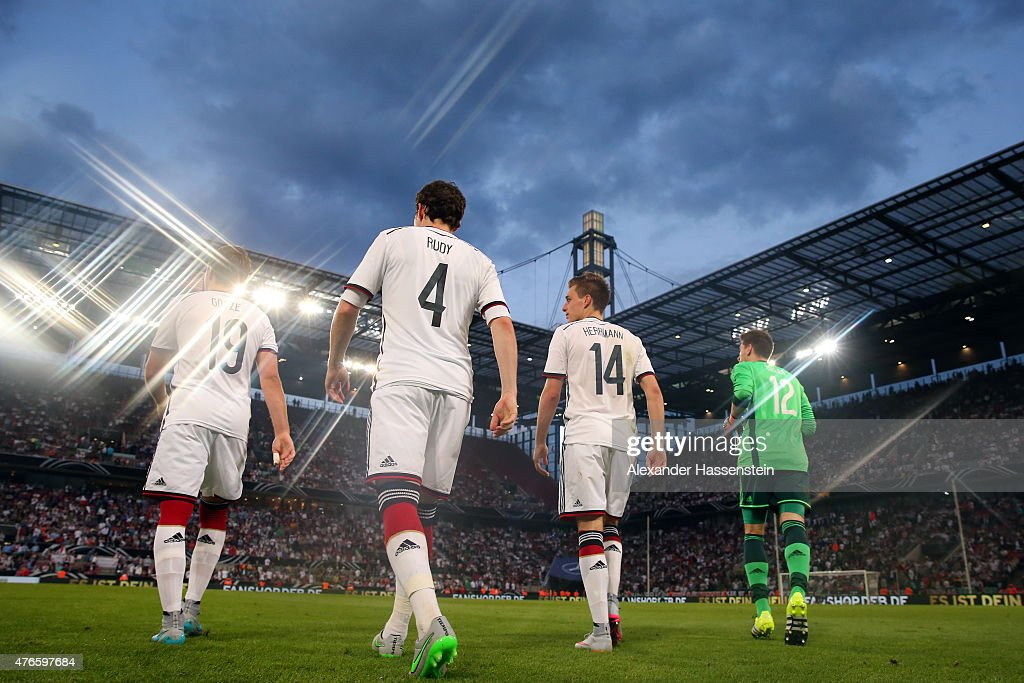 Mario Goetze of Germany enters the field with his team mates Sebastian Rudy Patrick Herrmann and keeper RonRobert Zieler for the international...
