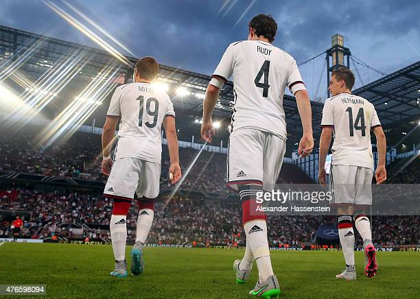 Mario Goetze of Germany enters the field with his team mates Sebastian Rudy and Patrick Herrmann for the international friendly match between Germany...