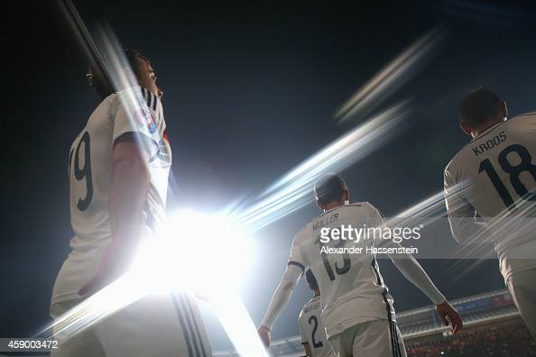 Mario Goetze of Germany enters the field with his team mates Thomas Mueller and Toni Kroos for the EURO 2016 Group D Qualifier match between Germany...