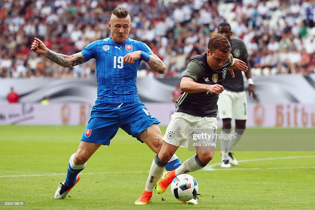 Mario Goetze of Germany is fouled for a penalty by Juray Kucka of Slovakia during the international friendly match between Germany and Slovakia at WWK-Arena on May 29, 2016 in Augsburg, Germany.