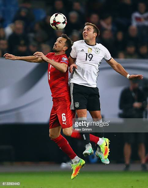 Mario Goetze of Germany jumps for a header with Tomas Sivok of Czech Republic during the FIFA World Cup 2018 qualifying match between Germany and...