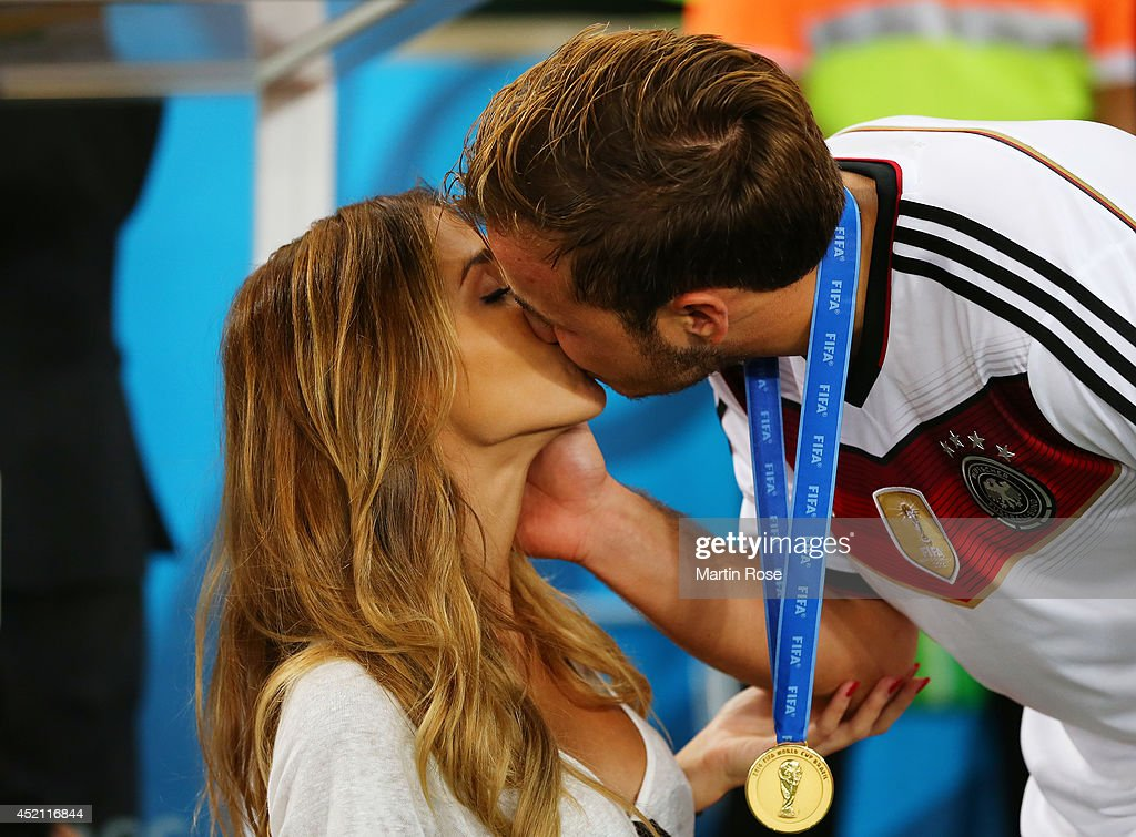 Mario Goetze of Germany kisses girlfriend Ann-Kathrin Brommel after defeating Argentina 1-0 in extra time during the 2014 FIFA World Cup Brazil Final match between Germany and Argentina at Maracana on July 13, 2014 in Rio de Janeiro, Brazil.