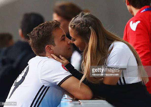 Mario Goetze of Germany kisses his girlfriend AnnKathrin Broemmel after the UEFA EURO 2016 round of 16 match between Germany and Slovakia at Stade...