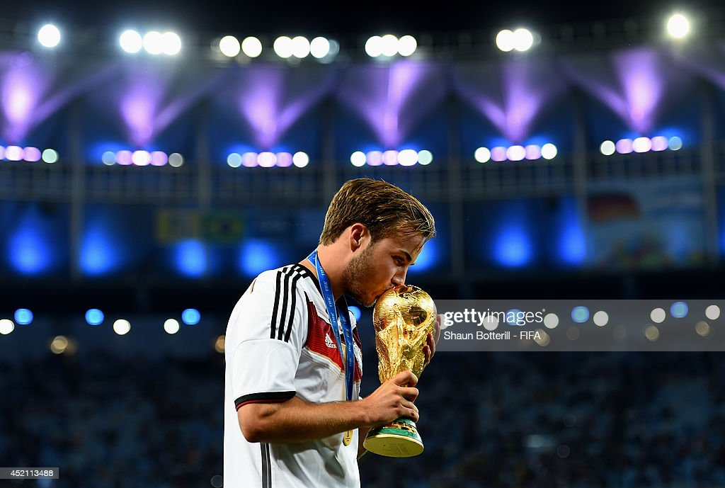 <a gi-track='captionPersonalityLinkClicked' href=/galleries/search?phrase=Mario+Goetze&family=editorial&specificpeople=4251202 ng-click='$event.stopPropagation()'>Mario Goetze</a> of Germany kisses the World Cup trophy after the 2014 FIFA World Cup Brazil Final match between Germany and Argentina at Maracana on July 13, 2014 in Rio de Janeiro, Brazil.