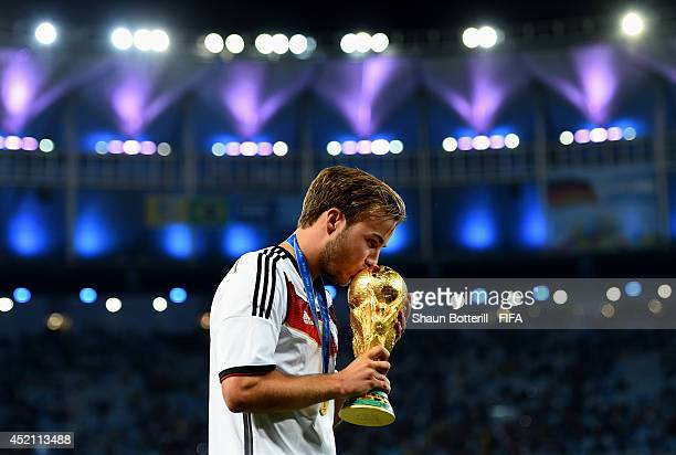 Mario Goetze of Germany kisses the World Cup trophy after the 2014 FIFA World Cup Brazil Final match between Germany and Argentina at Maracana on...