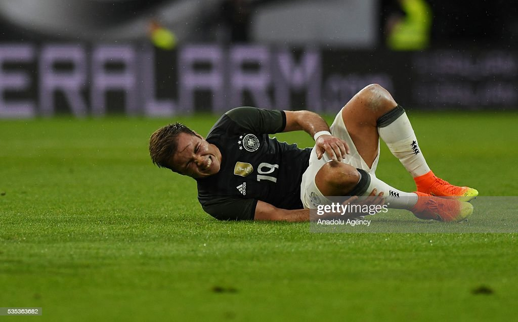 Mario Goetze of Germany lies on the field during the friendly football match between Germany and Slovakia at the WWK Arena in Augsburg, Germany on May 29, 2016.
