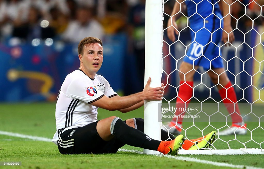 Mario Goetze of Germany reacts as he sits on the turf during the UEFA EURO semi final match between Germany and France at Stade Velodrome on July 7, 2016 in Marseille, France.