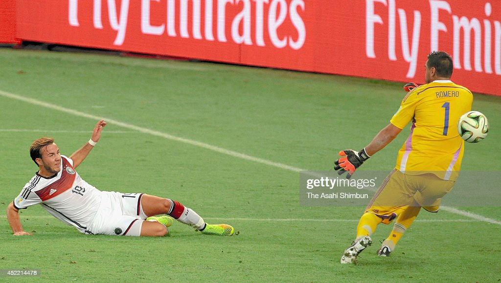 <a gi-track='captionPersonalityLinkClicked' href=/galleries/search?phrase=Mario+Goetze&family=editorial&specificpeople=4251202 ng-click='$event.stopPropagation()'>Mario Goetze</a> of Germany scores his team's first goal during the 2014 FIFA World Cup Brazil Final match between Germany and Argentina at Maracana on July 13, 2014 in Rio de Janeiro, Brazil.