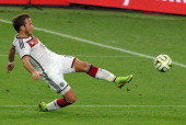Mario Goetze of Germany scores his team's first goal during the 2014 FIFA World Cup Brazil Final match between Germany and Argentina at Maracana on...