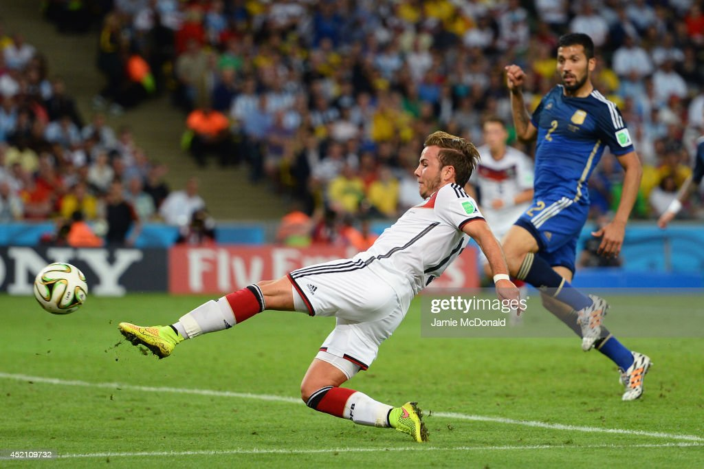 <a gi-track='captionPersonalityLinkClicked' href=/galleries/search?phrase=Mario+Goetze&family=editorial&specificpeople=4251202 ng-click='$event.stopPropagation()'>Mario Goetze</a> of Germany scores his team's first goal in extra time during the 2014 FIFA World Cup Brazil Final match between Germany and Argentina at Maracana on July 13, 2014 in Rio de Janeiro, Brazil.