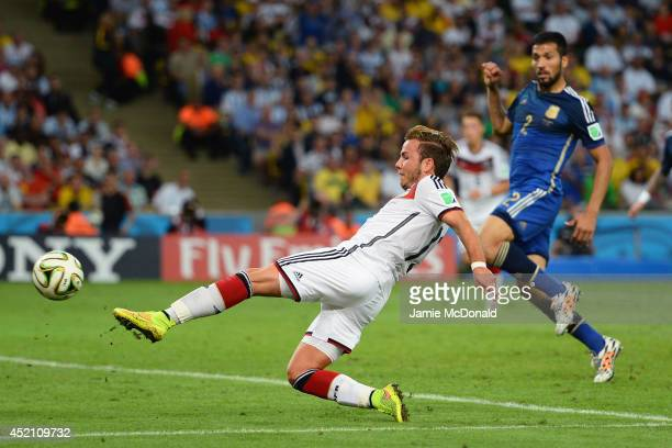 Mario Goetze of Germany scores his team's first goal in extra time during the 2014 FIFA World Cup Brazil Final match between Germany and Argentina at...