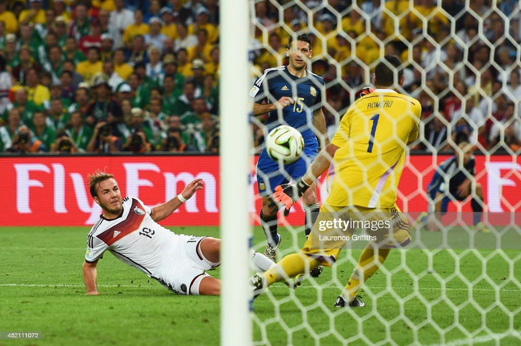 <a gi-track='captionPersonalityLinkClicked' href=/galleries/search?phrase=Mario+Goetze&family=editorial&specificpeople=4251202 ng-click='$event.stopPropagation()'>Mario Goetze</a> of Germany scores his team's first goal past <a gi-track='captionPersonalityLinkClicked' href=/galleries/search?phrase=Sergio+Romero&family=editorial&specificpeople=4100804 ng-click='$event.stopPropagation()'>Sergio Romero</a> of Argentina in extra time during the 2014 FIFA World Cup Brazil Final match between Germany and Argentina at Maracana on July 13, 2014 in Rio de Janeiro, Brazil.