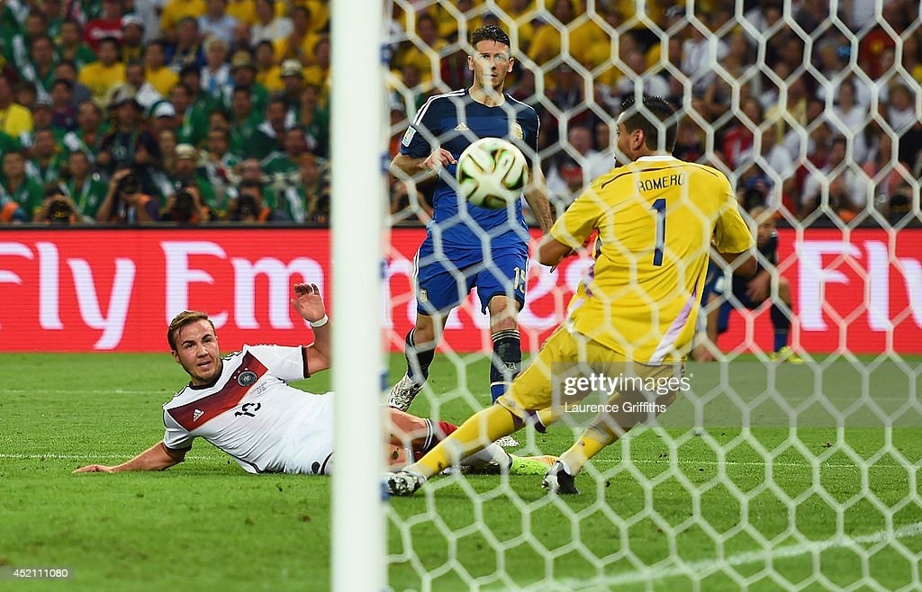 Mario Goetze of Germany scores his team's first goal past Sergio Romero of Argentina in extra time during the 2014 FIFA World Cup Brazil Final match between Germany and Argentina at Maracana on July 13, 2014 in Rio de Janeiro, Brazil.