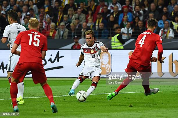 Mario Goetze of Germany scores his team's second goal during the EURO 2016 Qualifier Group D match between Germany and Poland at CommerzbankArena on...