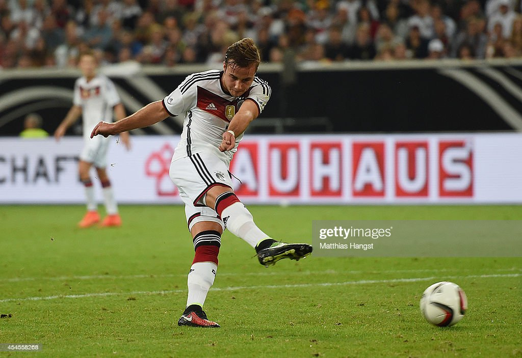 <a gi-track='captionPersonalityLinkClicked' href=/galleries/search?phrase=Mario+Goetze&family=editorial&specificpeople=4251202 ng-click='$event.stopPropagation()'>Mario Goetze</a> of Germany scores his team's second goal during the international friendly match between Germany and Argentina at Esprit-Arena on September 3, 2014 in Duesseldorf, Germany.