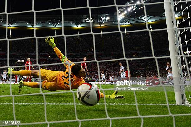 Mario Goetze of Germany scores his team's second goal past Lukasz Fabianski of Poland during the EURO 2016 Qualifier Group D match between Germany...