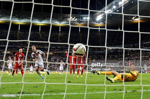 Mario Goetze of Germany scores his teams third goal during the EURO 2016 Qualifier Group D match between Germany and Poland at CommerzbankArena on...