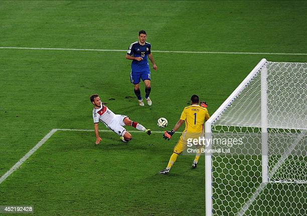 Mario Goetze of Germany scores the opening goal past Sergio Romero of Argentina during the 2014 World Cup Final match between Germany and Argentina...
