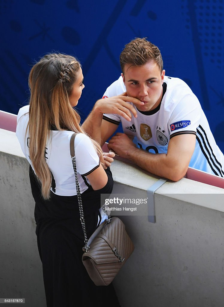 Mario Goetze of Germany talks with his girlfriend Ann-Kathrin Broemmel after the UEFA EURO 2016 round of 16 match between Germany and Slovakia at Stade Pierre-Mauroy on June 26, 2016 in Lille, France.