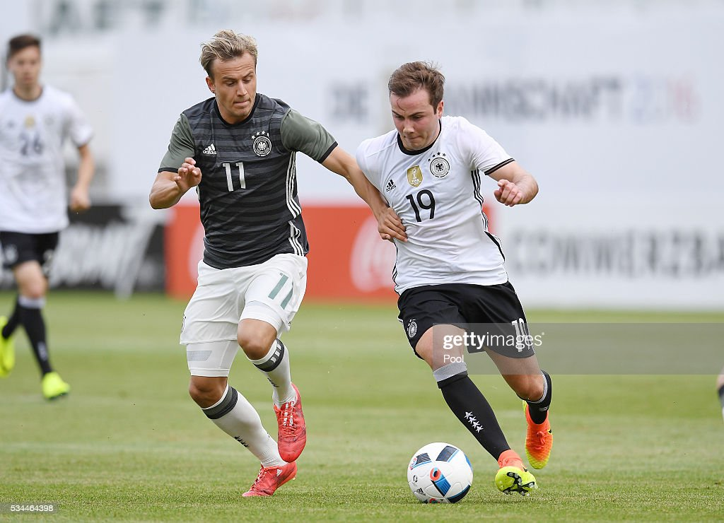 <a gi-track='captionPersonalityLinkClicked' href=/galleries/search?phrase=Mario+Goetze&family=editorial&specificpeople=4251202 ng-click='$event.stopPropagation()'>Mario Goetze</a> (R) of Germany vies with Felix Lohkemper of Germany U20 during a friendly match as part of their training camp on May 26, 2016 in Ascona, Switzerland.