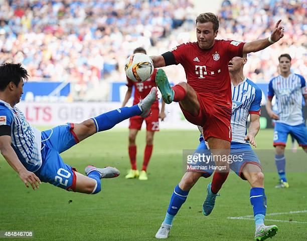 Mario Goetze of Muenchen and JinSu Kim of Hoffenheim compete for the ball during the Bundesliga match between 1899 Hoffenheim and FC Bayern Muenchen...