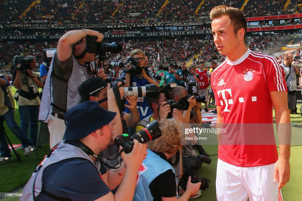 <a gi-track='captionPersonalityLinkClicked' href=/galleries/search?phrase=Mario+Goetze&family=editorial&specificpeople=4251202 ng-click='$event.stopPropagation()'>Mario Goetze</a> of Muenchen arrives for the Bundesliga match between Eintracht Frankfurt and FC Bayern Muenchen at Commerzbank Arena on August 17, 2013 in Frankfurt am Main, Germany.