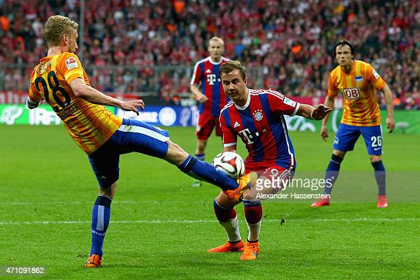 Mario Goetze of Muenchen battles for the ball with Fabian Lustenberger of Berlin during the Bundesliga match between FC Bayern Muenchen and Hertha...