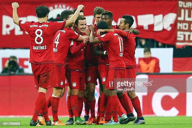 Mario Goetze of Muenchen celebrates his team's fifth goal with team mates during the Bundesliga match between FC Bayern Muenchen and Borussia...