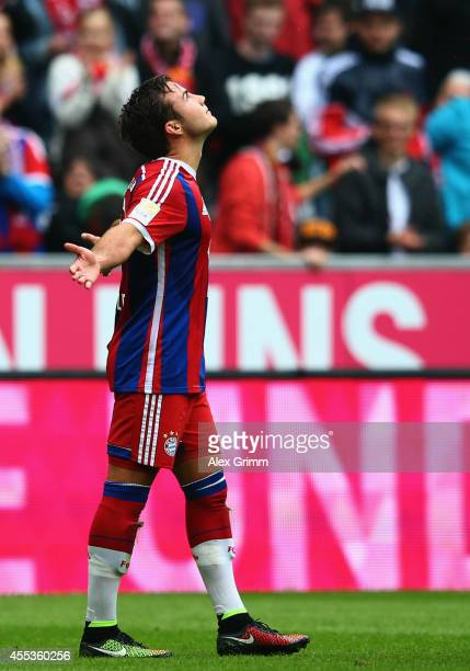 Mario Goetze of Muenchen celebrates his team's first goal during the Bundesliga match between FC Bayern Muenchen and VfB Stuttgart at Allianz Arena...