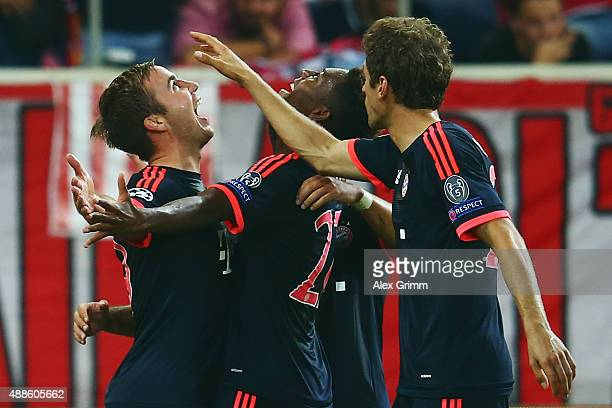 Mario Goetze of Muenchen celebrates his team's second goal with team mates Kingsley Coman and Thomas Mueller during the UEFA Champions League Group F...