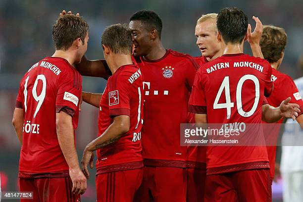 Mario Goetze of Muenchen celebrates scoring the first goal with his team mates during the international friendly match between FC Bayern Muenchen and...