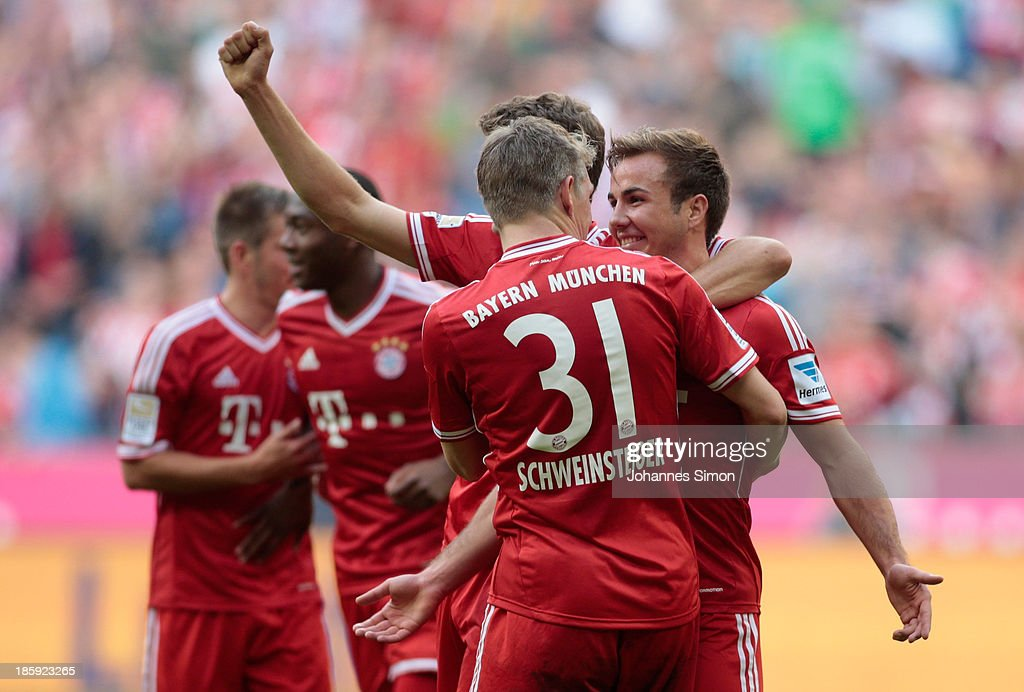 <a gi-track='captionPersonalityLinkClicked' href=/galleries/search?phrase=Mario+Goetze&family=editorial&specificpeople=4251202 ng-click='$event.stopPropagation()'>Mario Goetze</a> (R) of Muenchen celebrates with team mates after scoring his team's 3rd goal during the Bundesliga match between FC Bayern Muenchen and Hertha BSC Berlin at Allianz Arena at Allianz Arena on October 26, 2013 in Munich, Germany.
