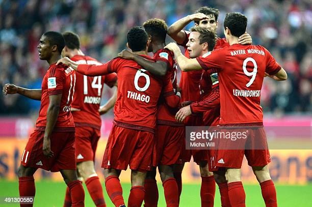 Mario Goetze of Muenchen celebrates with teammates after scoring his team's fifth goal during the Bundesliga match between FC Bayern Muenchen and...