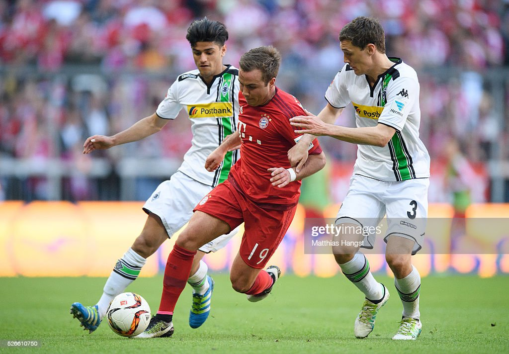 Mario Goetze of Muenchen is challenged by <a gi-track='captionPersonalityLinkClicked' href=/galleries/search?phrase=Andreas+Christensen+-+Fu%C3%9Fballspieler&family=editorial&specificpeople=15506880 ng-click='$event.stopPropagation()'>Andreas Christensen</a> of Gladbach during the Bundesliga match between FC Bayern Muenchen and Borussia Moenchengladbach at Allianz Arena on April 30, 2016 in Munich, Germany.