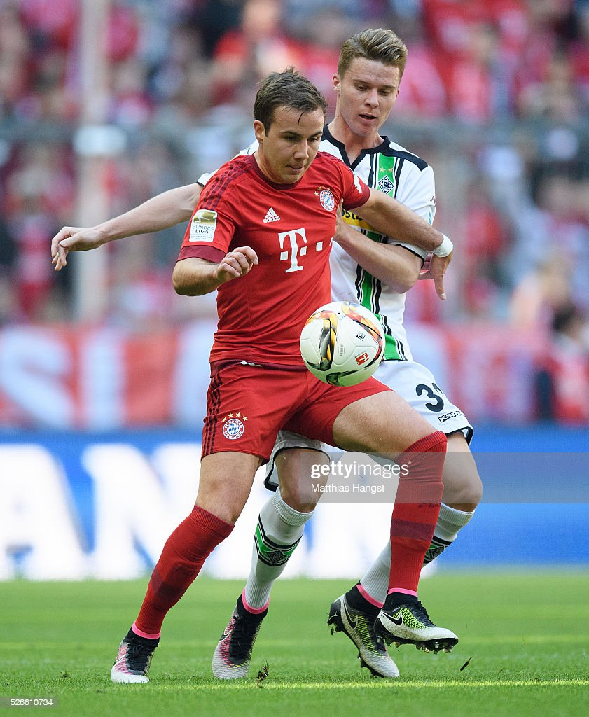 <a gi-track='captionPersonalityLinkClicked' href=/galleries/search?phrase=Mario+Goetze&family=editorial&specificpeople=4251202 ng-click='$event.stopPropagation()'>Mario Goetze</a> of Muenchen is challenged by Nico Elvedi of Gladbach during the Bundesliga match between FC Bayern Muenchen and Borussia Moenchengladbach at Allianz Arena on April 30, 2016 in Munich, Germany.