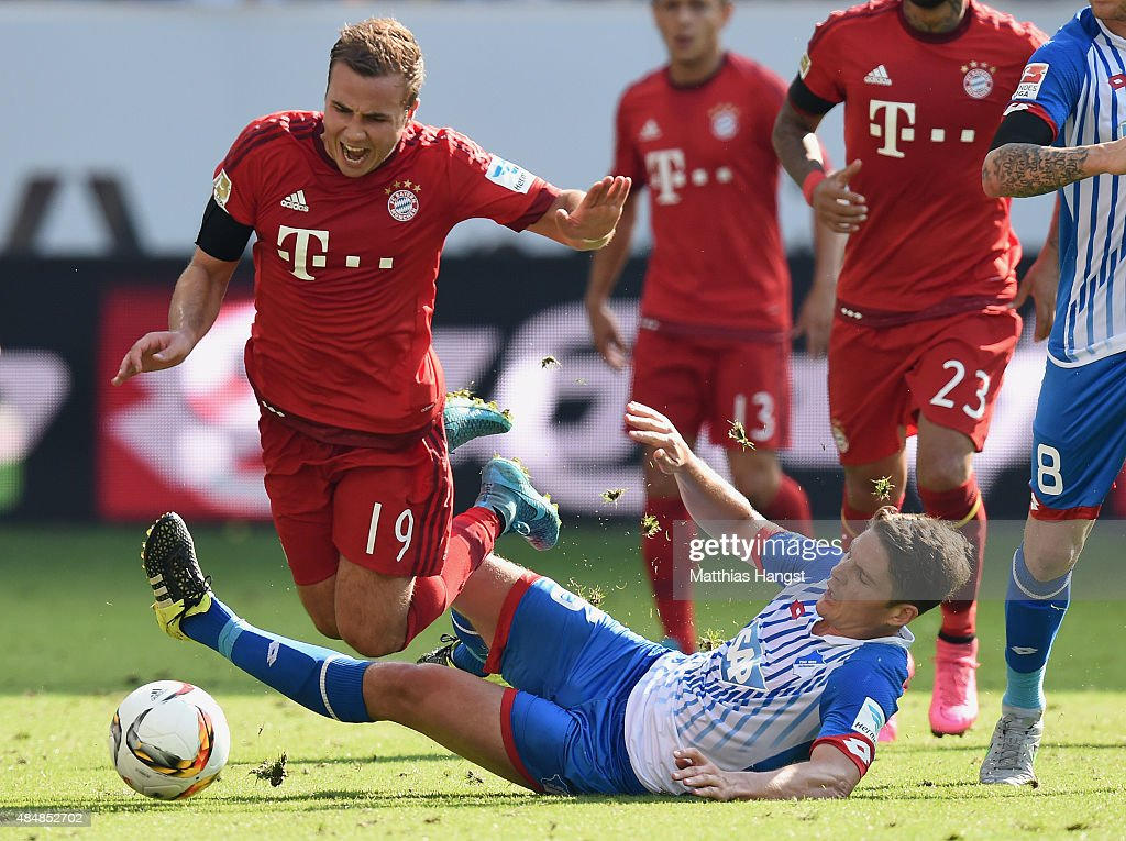<a gi-track='captionPersonalityLinkClicked' href=/galleries/search?phrase=Mario+Goetze&family=editorial&specificpeople=4251202 ng-click='$event.stopPropagation()'>Mario Goetze</a> (L) of Muenchen is challenged by <a gi-track='captionPersonalityLinkClicked' href=/galleries/search?phrase=Pirmin+Schwegler&family=editorial&specificpeople=604263 ng-click='$event.stopPropagation()'>Pirmin Schwegler</a> of Hoffenheim during the Bundesliga match between 1899 Hoffenheim and FC Bayern Muenchen at Wirsol Rhein-Neckar-Arena on August 22, 2015 in Sinsheim, Germany.
