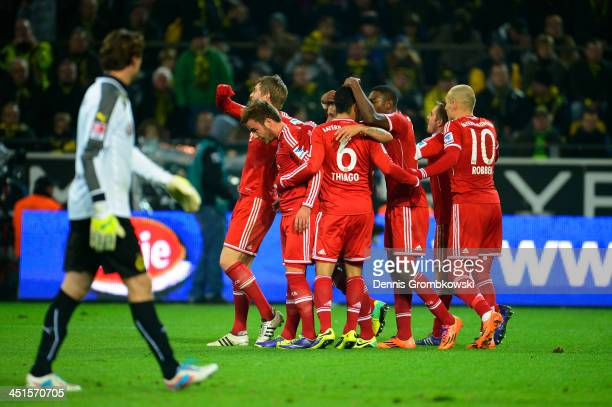 Mario Goetze of Munich celebrates with team mates after scoring the opening goal during the Bundesliga match between Borussia Dortmund and FC Bayern...