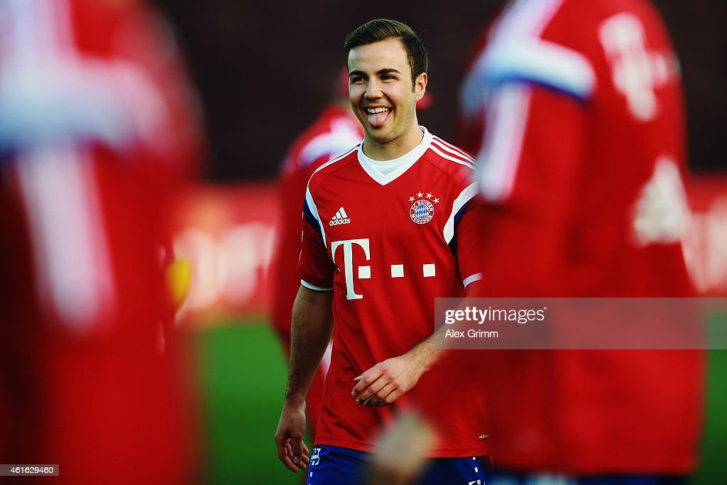 <a gi-track='captionPersonalityLinkClicked' href=/galleries/search?phrase=Mario+Goetze&family=editorial&specificpeople=4251202 ng-click='$event.stopPropagation()'>Mario Goetze</a> reacts during day 8 of the Bayern Muenchen training camp at ASPIRE Academy for Sports Excellence on January 16, 2015 in Doha, Qatar.