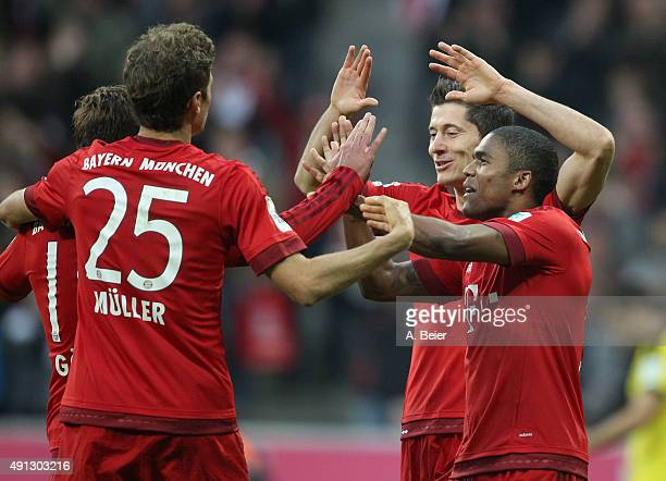 Mario Goetze Thomas Mueller Robert Lewandowski and Douglas Costa of Bayern Muenchen celebrate Goetze's goal during the Bundesliga match between FC...
