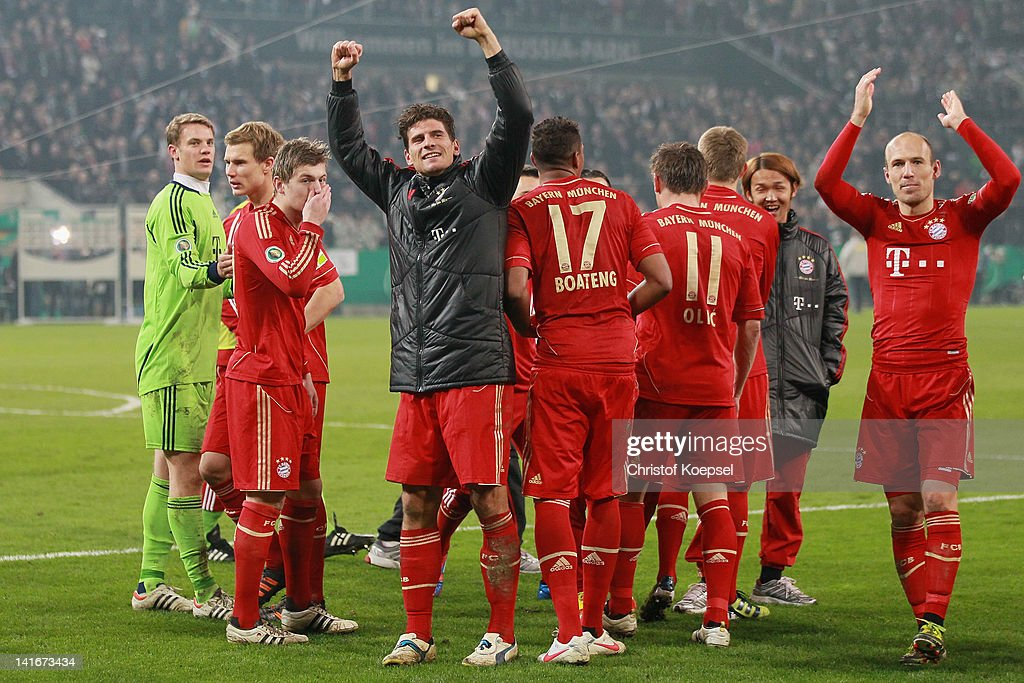 Mario Gomez and Arjen Robben of Bayern embraces Manuel Neuer (3rd R) after winning 4-2 after penalty shoot-out after the DFB Cup semi final match between Borussia Moenchengladbach and FC Bayern Muenchen at Borussia Park Stadium on March 21, 2012 in Moenchengladbach, Germany.
