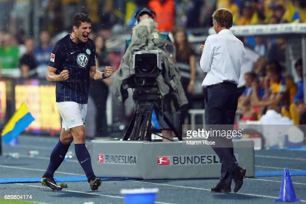 Mario Gomez and head coach Andries Jonker react after Gomez' substitution during the Bundesliga Playoff leg 2 match between Eintracht Braunschweig...