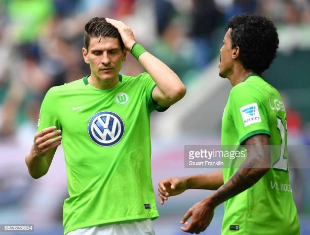Mario Gomez and Luiz Gustavo of Wolfsburg look dejected during the Bundesliga match between VfL Wolfsburg and Borussia Moenchengladbach at Volkswagen...