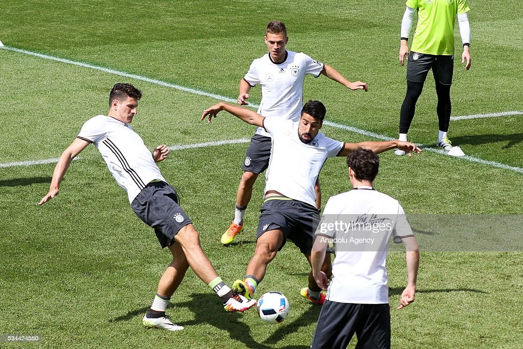 Mario Gomez (L) and Sami Khedira (C) of German National Football Team attend a training session at Lago Maggiore in Ascona, Switzerland on May 26, 2016. Germany's national soccer team prepares for the upcoming UEFA EURO 2016, to be held in France, in a training camp in Ascona.