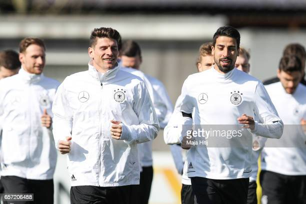 Mario Gomez and Sami Khedira run during training of German national team ahead of the FIFA World Cup qualification match 2018 against Azerbaijan on...