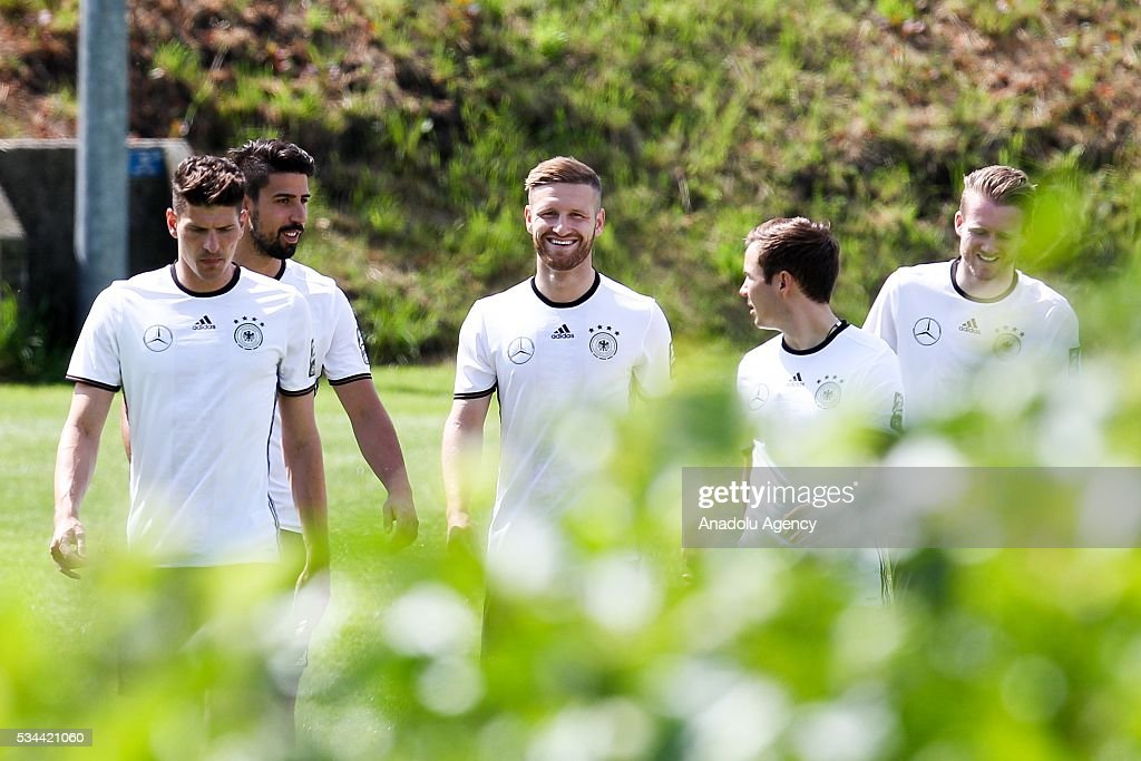 Mario Gomez (L) and Shkodran Mustafi (C) of German National Football Team attend a training session at Lago Maggiore in Ascona, Switzerland on May 26, 2016. Germany's national soccer team prepares for the upcoming UEFA EURO 2016, to be held in France, in a training camp in Ascona.
