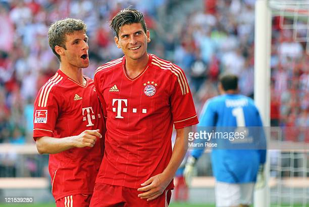 Mario Gomez celebrate his goal with teammate Thomas Mueller during the Bundesliga match between FC Bayern Muenchen and Hamburger SV at Allianz Arena...